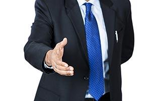 Businessman Offering Handshake Deal Midsection
