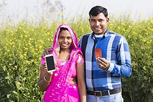 Rural Couple Farm Showing Cellphone Credit Card Sh