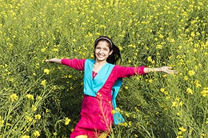 Rural Young Girl Field Arms Outstretched Enjoy Smi