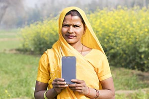 Rural Farmer Woman Field Showing Smartphone Qualit
