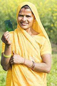 Rural Woman Field Showing Debit Card Smiling