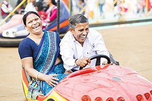 Indian Senior Couple Fun Fair Riding Bumpercar