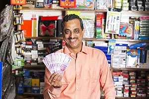 Stationery Shop Shopkeeper Man Showing Money