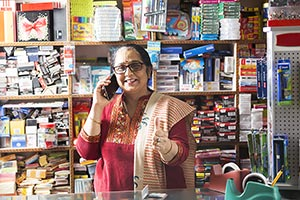 Shopkeeper Woman Talking Cellphone Stationery Shop