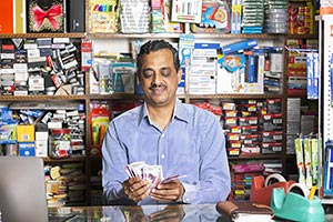 Stationery Shop Shopkeeper Man Counting Money