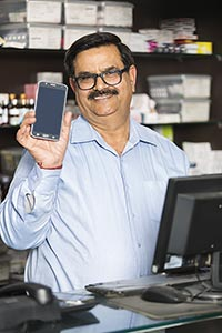 Chemists Shop Shopkeeper Man Showing Cellphone