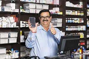Chemists Shop Shopkeeper Man Showing Smartphone Th
