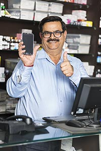 Chemists Shop Shopkeeper Man Showing Cellphone Thu