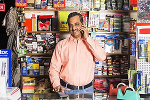 Stationery Shop Shopkeeper Man Talking Phone