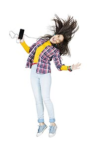 Happy Young Woman Jumping Earbuds listening Music