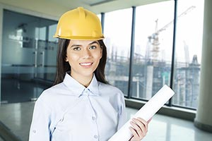 Business Woman Engineer construction site holding