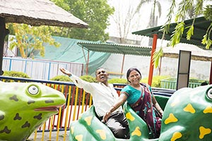 Senior Couple Fair Ride Enjoying Amusement Park