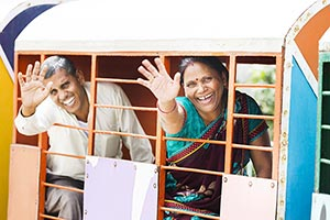 Indian Senior Couple Ride Train Fun Bye-Bye