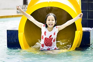 Little Girl Slide Waterpark Swimming Pool Fun