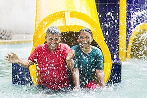 Senior Couple Bathing Waterpark Enjoy Summer Vacat