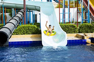 Man Sliding Down Water Slide Innertube Waterpark