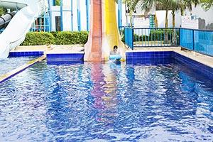 Man Sliding Splashing Waterpark Swimming Pool Fun