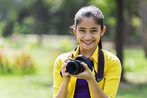 Young Indian Girl Cameraman Park Photography Smili