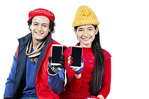 Young Couple Winter Clothe Showing New Smartphone