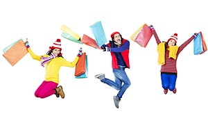 Teenager Friends Winter Shopping Bags Jumping Fun