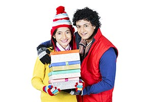 Young Couple Winter Birthday Gift Box Showing