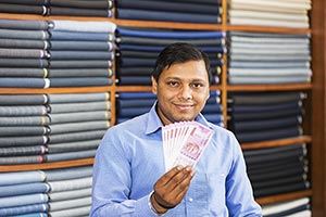 Shop Keeper Salesperson Man Showing Money Rupees