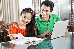 Father Helping Daughter Education Book Laptop