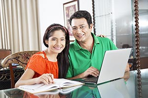 Father Teaching Daughter Studying Book Laptop