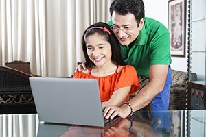 Father Teaching Daughter Laptop Studying Education