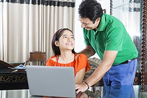 Father Teaching Daughter Laptop Studying At Home