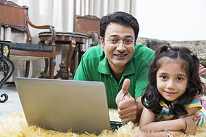 Father Kid Daughter At home Laptop Thumbeup