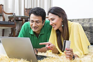 Couple Credit Card Laptop Pointing Online Shopping