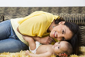 happy mother newborn baby Caress at home