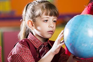 Little Girl School Student Globe Searching Studyin