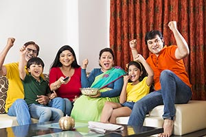 Happy Indian Big family watching Cricket match on