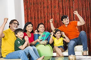 Happy Big family watching Cricket match on Tv Succ