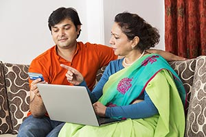 Son And Senior Mother Laptop Credit Card Pointing