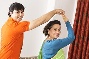 Adult Son And Senior Mother Dancing Rotating Havin