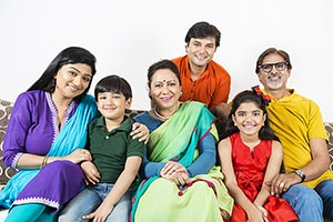 Portrait of smiling Big family with Kids while sit