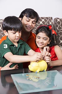 Father And Kids Saving Money Inserting Coin Piggy
