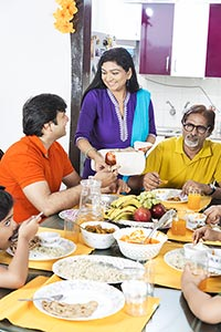 Indian Family Dining Table Eating Food Woman Servi