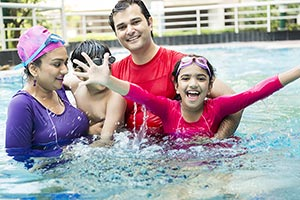 Happy Parents And Children Bathing Swimming pool H