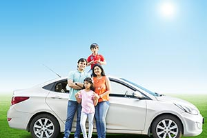 Happy Indian Family Standing by a car Park Travel