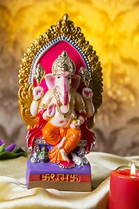 Small statue of Lord Ganesha Pooja arrangement at