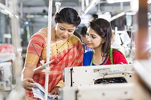 Indian Women Worker Tailor Sewing Factory and Mana