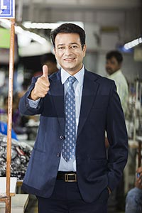 1 Indian Business man Standing In Factory and Show
