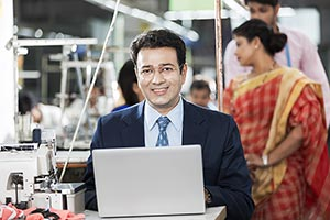 1 Happy Business man Manager Using Laptop In Facto