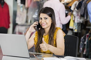 Young woman Boutique Shop owner talking phone and