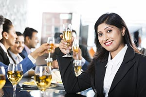 Businesswoman Drinking Champagne with colleagues i