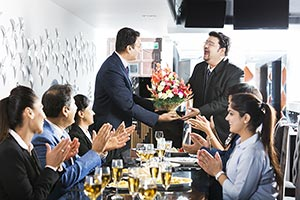 Group Business People giving Bouquet colleague Wel